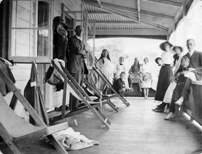 The Douglas family on the deck of their holiday home at Castor Bay
