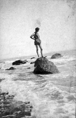 Margaret Douglas on a rock in the sea - Wairuaterangi