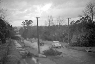 Blurry image of street with debris from Frankton tornado