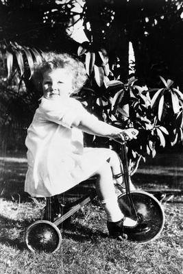 Barbara Graham with tricycle. Age 2 years and 9 months