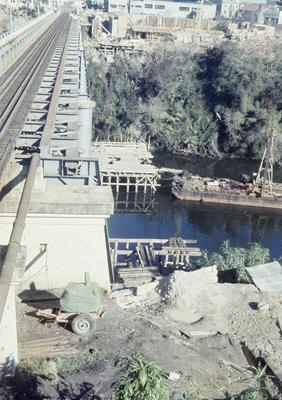 Construction of the State Advances Corporation building and the new railway bridge begins