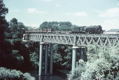 A locomotive crosses the original Hamilton Railway Bridge