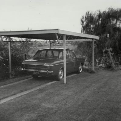 A Hillman Hunter car in a carport