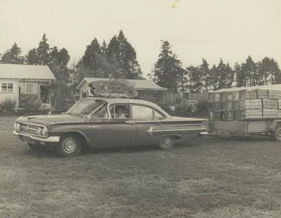 Gloria Powell in Chevrolet Bel Air with trailer of pheasant
