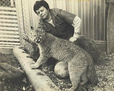Gloria Powell with lion cub