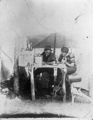 Men in shelter at Wairere