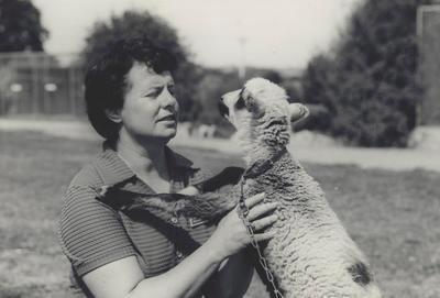 Gloria Powell with kid? (goat)