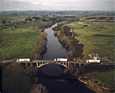 Aerial of Huttons trucks crossing Horotiu Bridge