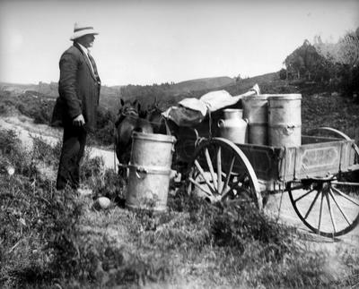 Cart loaded with milk churns at Whitehall School