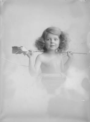 Portrait of a child with bow and arrows