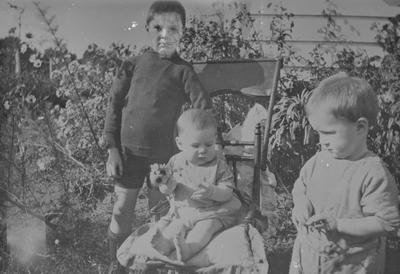 Copy of snapshot of 3 children in a garden