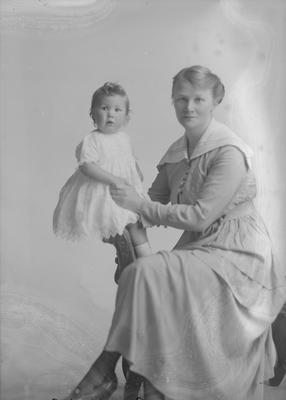 Full portrait of woman and baby