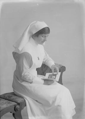 Woman in registered nurse's uniform