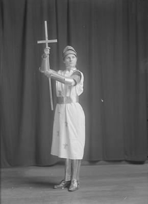 Full length portrait of woman dressed as Joan of Arc