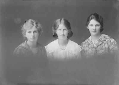 Head and shoulders portrait of three young women