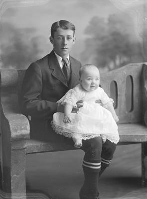 Portrait of young man and baby