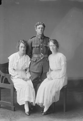Portrait of two women and a man in World War 1 uniform