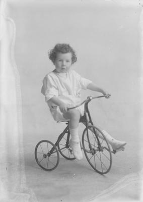 Small boy on tricycle - Nolan