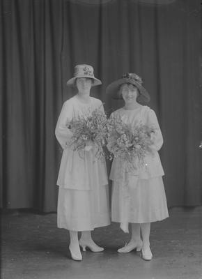 Full length portrait of bride and bridesmaid - Poham
