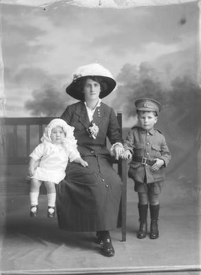Full lenght portrait of woman with small girl and small boy McCauley