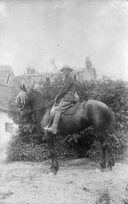 Portrait of a soldier on a horse