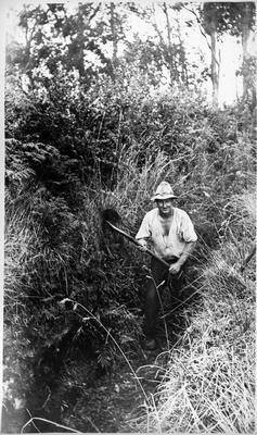 J Proctor digging a drain