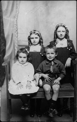 Portrait of four young children - three girls and one boy