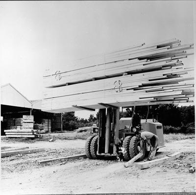 Fork lift with timber at Ellis & Burnand's Putaruru mill