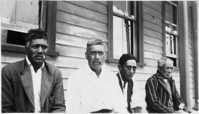 Four men outside Raglan Hotel