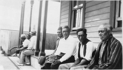 Seven men outside Raglan Hotel