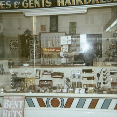 A barber shop window