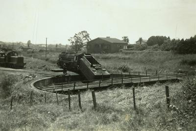 Locomotive train backed into turntable pit