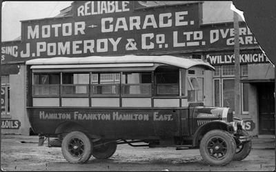 Hamilton - Frankton - Hamilton East bus outside Pomeroy's motor garage
