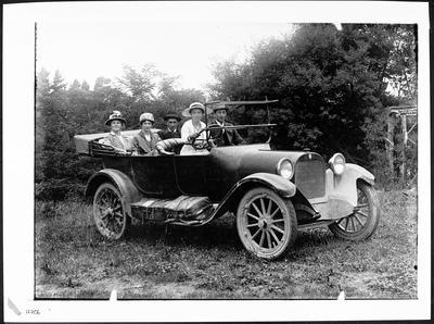 Motor car with five people