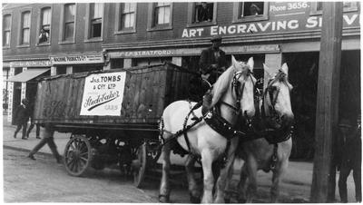 James Tombs & Co Ltd. Studebaker on horse drawn cart