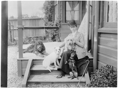 Woman and dogs on verandah - Hamilton