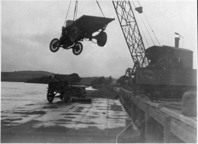 Loading vehicles onto barge