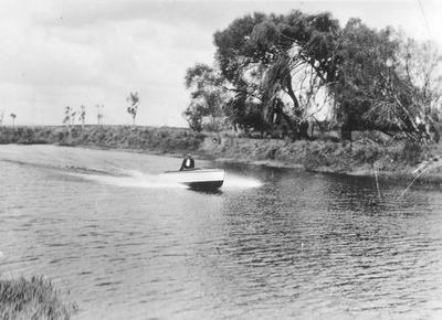 Ceasar in his speedboat - now sold - Waikato River