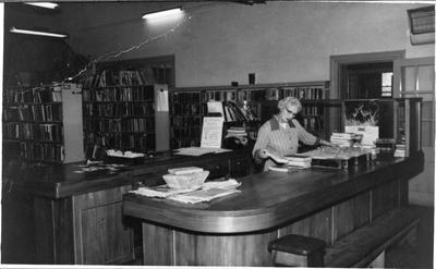 Maisie Forrest at issue desk - library