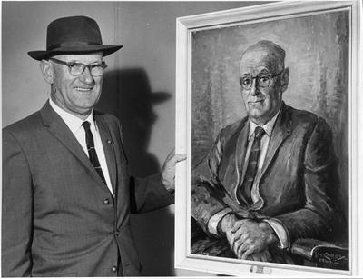Mr Campbell with a portrait of himself painted by Ida Carey