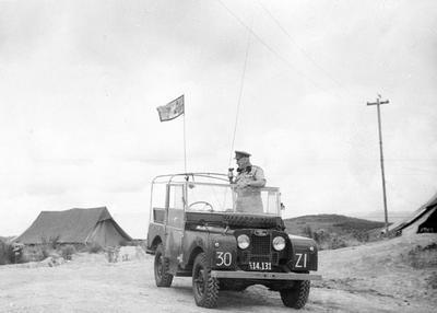 S T Nolan in army landrover