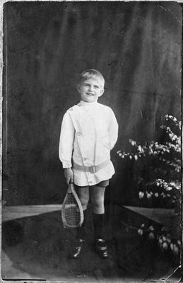 Mr Firth as a child in tennis clothes