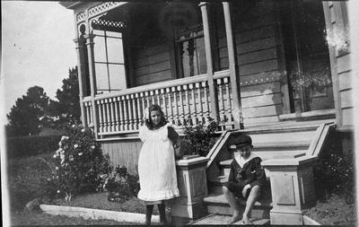 Two children on house steps