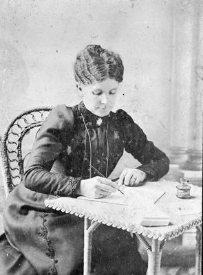 Mary Jane Innes writing using fountain pen, inkwell