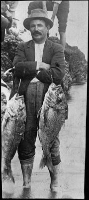 Charles Lewis Innes with two large fish