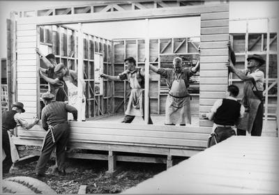 Ellis & Burnand constructing house in yard