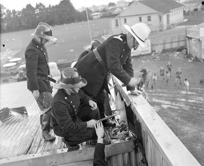 Firemen repairing flashing on a roof