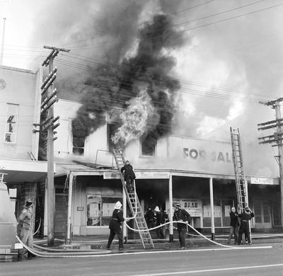 Firemen attending a fire on Victoria Street