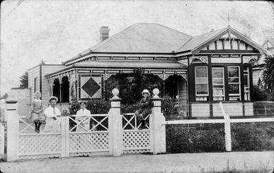 Booth family outside their home at 93 Ulster Street