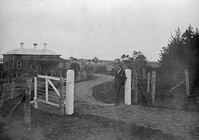 H. Douglas at gateway to Hockin House
